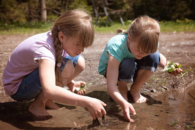 Restoring Habitat - girls finding frog eggs