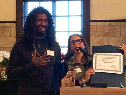 Mynzah Osiris receives Volunteer Award from Laura Jones