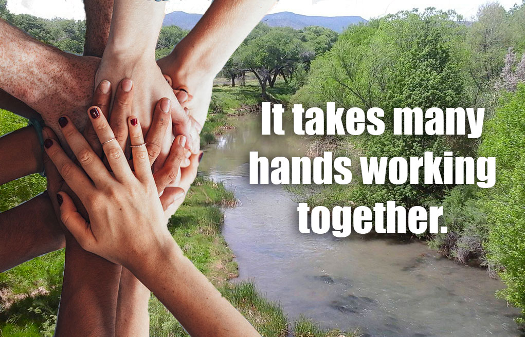 many hands working together